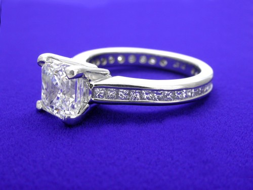 Asscher Cut Diamond Ring: 1.74 carat with 0.64 tcw Princess Cut diamonds