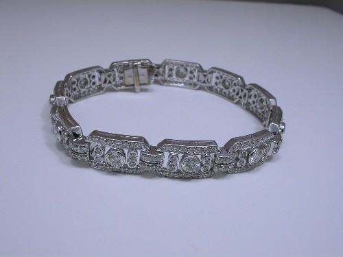 Diamond Bracelet: 5.80 tcw of round brilliant and pave set diamonds