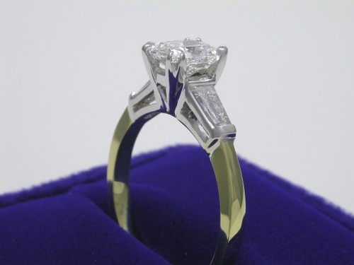 Cushion Cut Diamond Ring: 1.02 carat with 1.19 ratio  with 0.38 tcw tapered baguettes