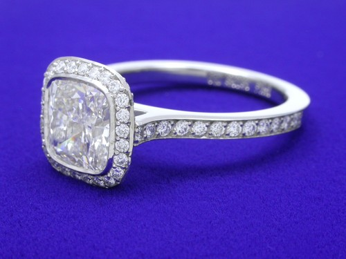 Cushion Cut Diamond Ring: 1.51 carat with 1.03 ratio and 0.37 tcw pave-set diamonds