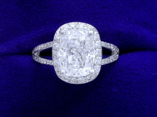 Cushion Cut Diamond Ring: 2.50 carat with 1.27 ratio and 0.45 tcw pave-set diamonds