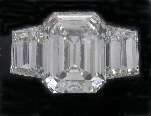 Emerald Cut Diamond 4.30 Carats 1.35 Ratio with 2.03 tcw Step Cut Trapezoids