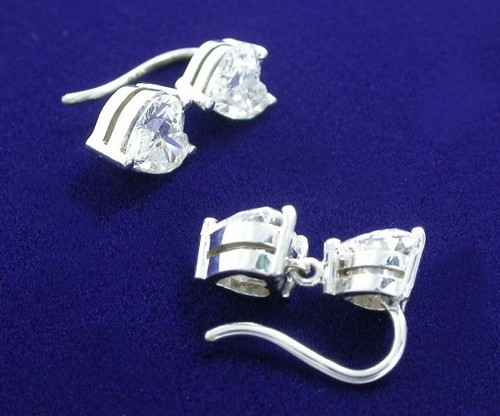Heart Shaped Diamond Earrings with 2.74 total carat weight