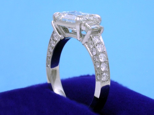 Emerald Cut Diamond Ring: 2.50 carat with 1.44 ratio and 0.34 tcw Trapezoids in 0.56 tcw pave mounti