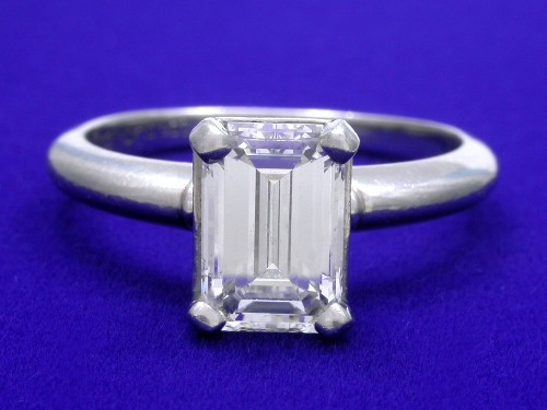 Emerald Cut Diamond Ring: 1.37 carat 1.51 ratio Basket style mounting