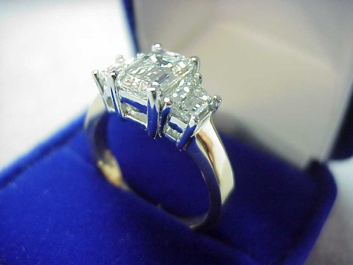 Emerald Cut Diamond Ring 1.69 carat 1.48 ratio with 0.96 Trapezoid side stones