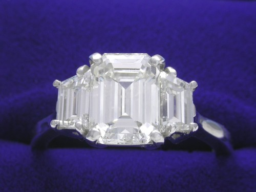 Emerald Cut Diamond Ring: 2.02 carat with 0.83 tcw Step-Cut Trapezoid Diamonds