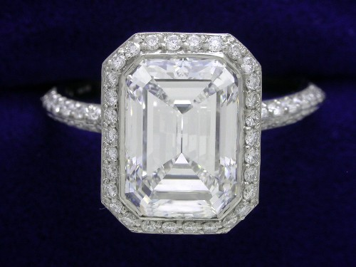 Emerald Cut Diamond Ring: 2.39 carat 1.39 ratio with 0.54 tcw side stones