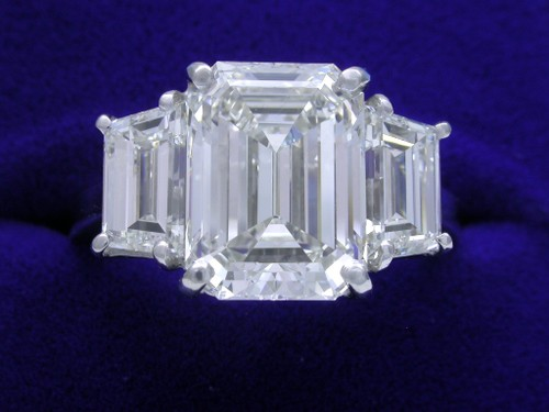 Emerald Cut Diamond Ring: 4.30 Carats 1.35 Ratio with 2.03 tcw Step Cut Trapezoid Side Diamonds