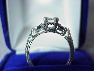 Emerald Cut Diamond Ring: 0.82 carats with 1.50 ratio and 0.26 tcw Blue Sapphires