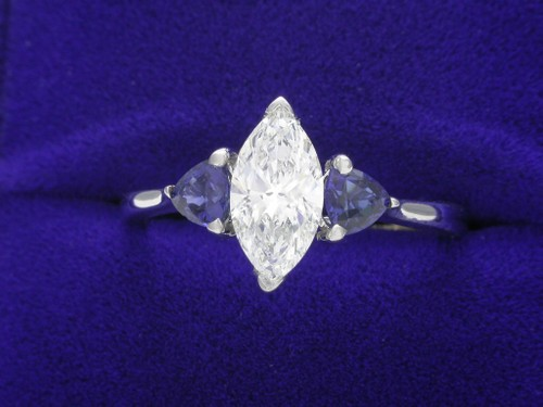 Marquise Cut Diamond Ring: 0.79 carat with Blue Sapphire Trillions