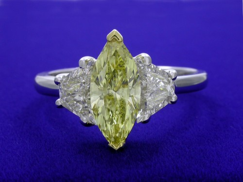 Marquise Cut Diamond Ring: 1.04 carat Fancy Intense Yellow with 0.81 tcw Crescent Moon Diamonds