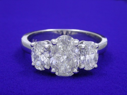 Oval Cut Diamond Ring: 1.03 carat with 0.76 tcw side Oval Diamonds