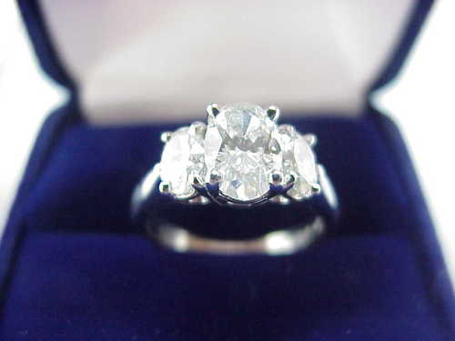 Oval Cut Diamond Ring: 1.03 carat with 0.65 tcw side Oval Diamonds
