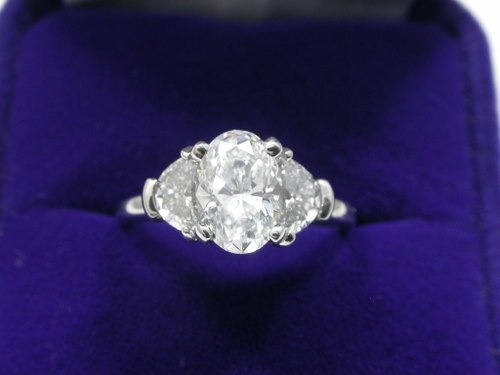 Oval Cut Diamond Ring: 1.08 carat with 0.60 tcw Crescent Moon diamonds