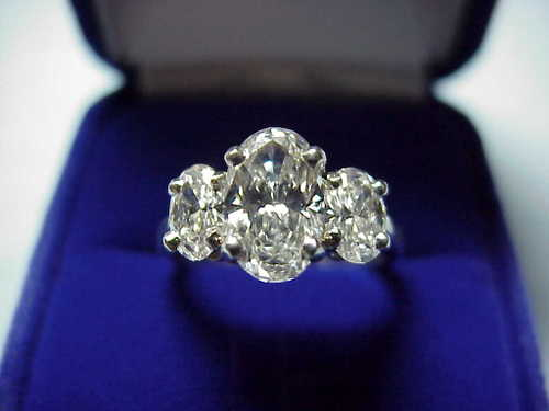Oval Cut Diamond Ring: 1.20 carat 1.58 ratio with 0.72 tcw Oval side stones