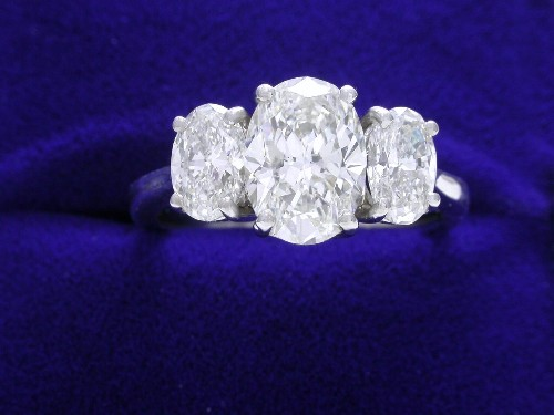 Oval Cut Diamond Ring: 1.33 carat with 0.90 tcw side stones