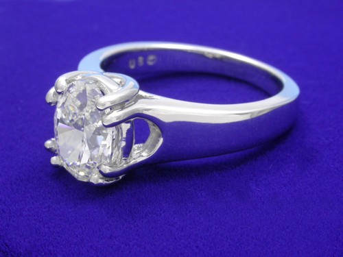 Oval Cut Diamond Ring: 1.51 carat in Trellis style double prong mounting