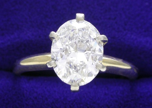 Oval Cut Diamond Ring: 1.51 carat 1.30 ratio in six prong Solitaire Mounting