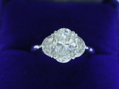 Oval Cut Diamond Ring: 1.51 carat with 0.68 tcw Half Moon diamonds