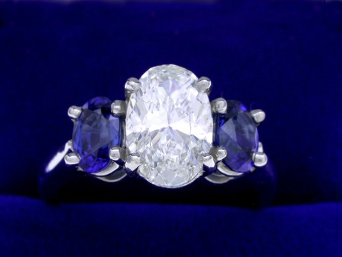 Oval Cut Diamond Ring: 1.70 carat with Oval Blue Sapphire