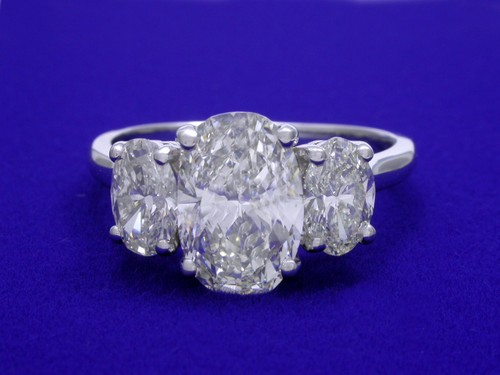 Oval Cut Diamond Ring: 1.78 carat with 0.96 tcw side Oval Diamonds