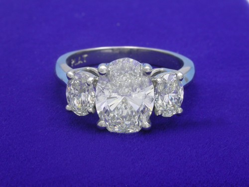 Oval Cut Diamond Ring: 2.01 carat with 0.83 tcw side Oval Diamonds
