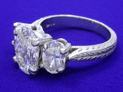 Oval Cut Diamond Ring: 2.01 carat 1.50 ratio with 1.40 tcw of Oval side stones