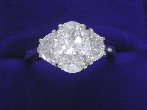 Oval Cut Diamond Ring: 2.05 Carats 1.41 Ratio with 0.71 tcw Crescent Half Moon Diamonds