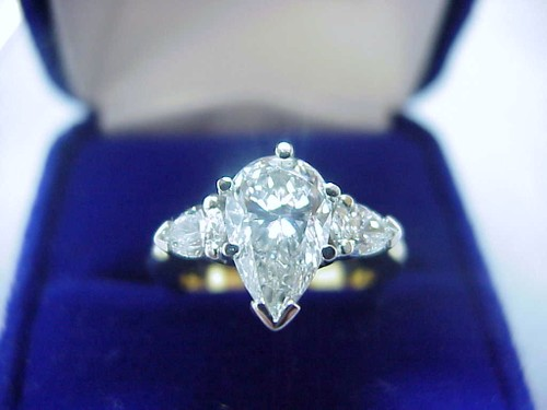 Pear Shaped Diamond Ring: 1.40 carat with 1.61 ratio and 0.40 tcw Pear Cut side diamonds