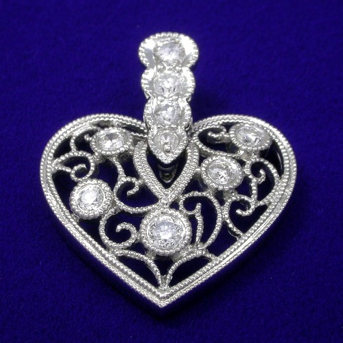 Round Brilliant Cut Diamond Pendant: 0.30 tcw in antique style mounting
