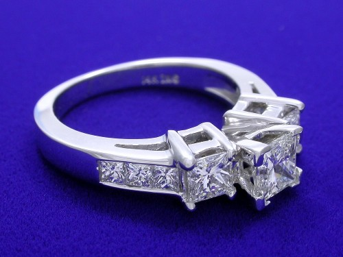 Princess Cut Diamond Ring: 0.51 carat with 0.93 tcw side stones Ingwer mounting