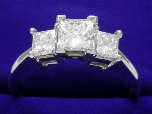 Princess Cut Diamond Ring: 0.70 carat with 0.68 tcw side stones