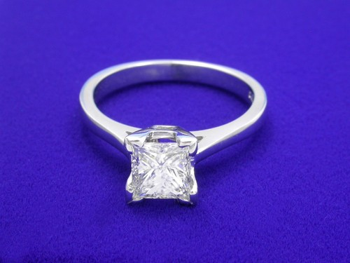 Princess Cut Diamond Ring: 0.90 carat in basket style mounting