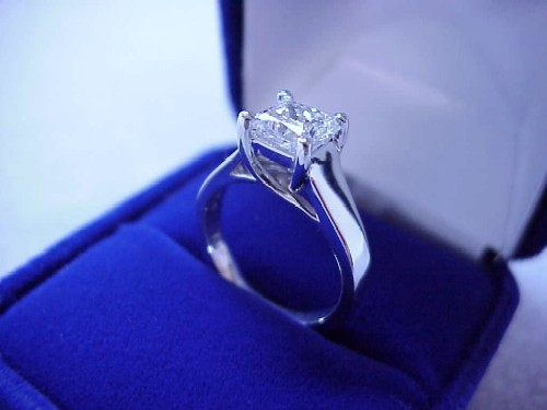 Princess Cut Diamond Ring: 0.90 carat in a Trellis style mounting