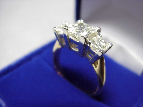 Princess Cut Diamond Ring: 0.91 carat with 0.78 tcw side stones