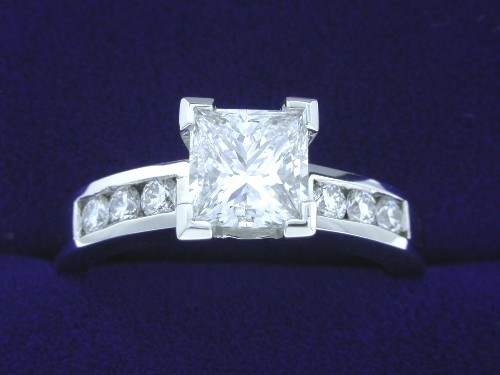 Princess Cut Diamond Ring: 1.01 carat with 0.24 total carat side stones Ingwer mounting