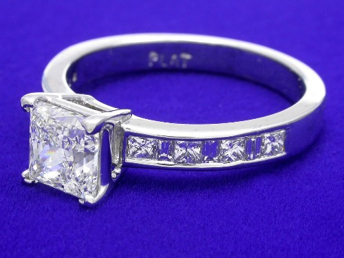 Princess Cut Diamond Ring: 1.18 carat 0.35 princess and 0.13 baguette side stones