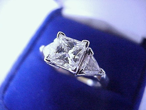 Princess Cut Diamond Ring: 1.21 carat with 0.52 tcw Trillion side stones