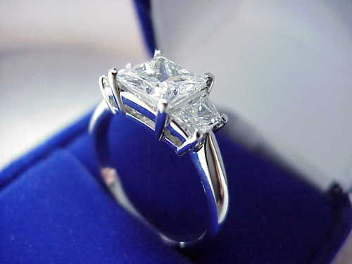 Princess Cut Diamond Ring: 1.46 carat with 0.63 tcw Brilliant Cut Trapezoid Diamonds