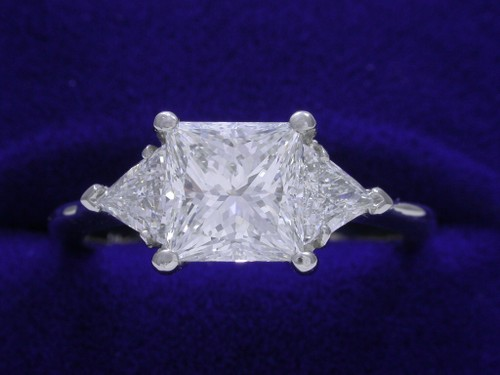 Princess Cut Diamond Ring: 1.52 carat with 0.39 tcw Trillion Side Diamonds