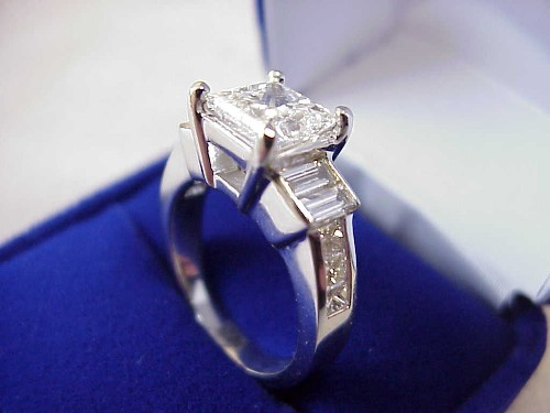 Princess Cut Diamond Ring: 1.70 carat with 1.15 tcw sides stones and Baguettes