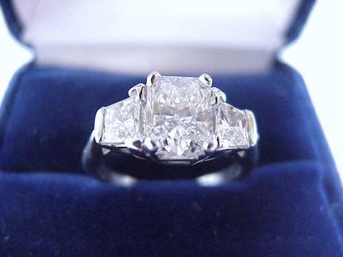 Radiant Cut Diamond Ring: 1.13 carat with 0.60 tcw Brilliant Cut Trapezoid Diamonds