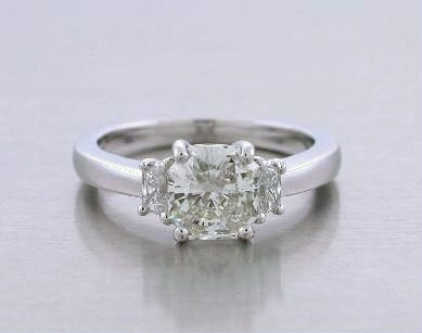 Radiant Cut Diamond Ring: 1.24 Carats 1.04 Ratio with 0.21 tcw Trapezoid Side Diamonds
