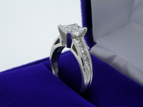 Radiant Cut Diamond Ring: 1.33 carat with 0.50 tcw princess cut diamonds