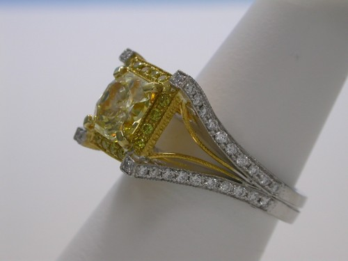 Radiant Cut Diamond Ring: 1.51 carat Fancy Yellow with 1.05 ratio and 1.05 tcw pave-set diamonds