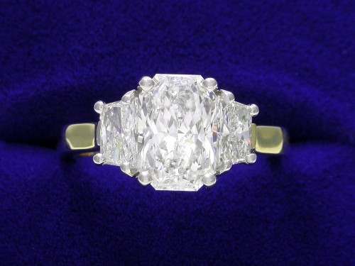 Radiant Cut Diamond Ring: 1.71 carat 1.47 ratio with 0.57 tcw Trapezoid side stones