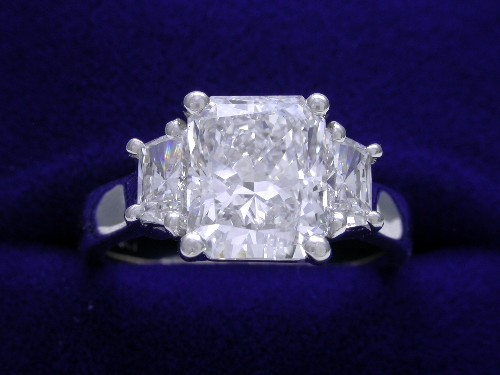 Radiant Cut Diamond Ring: 1.88 carat 1.21 ratio with 0.40 tcw Trapezoid side stones