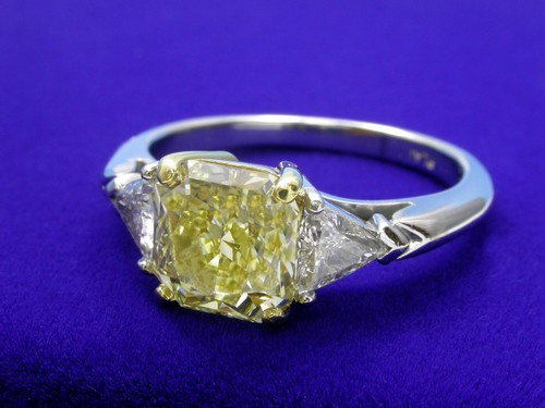 Radiant Cut Diamond Ring: 2.06 carat Fancy Yellow with 1.04 ratio and 0.50 tcw Trillion cut diamonds
