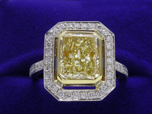 Radiant Cut Diamond Ring: 2.53 carat Fancy Light Yellow with Custom Pave Mounting